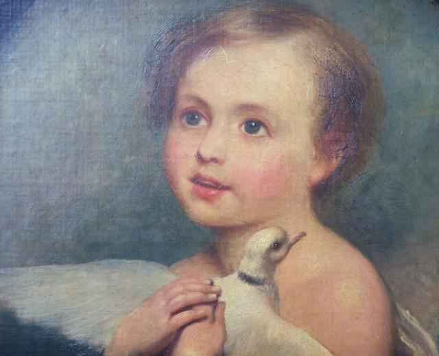 Child clasps dove