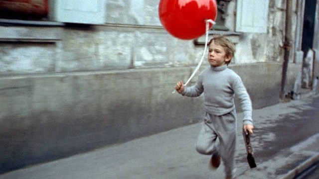 Lost boy with a red balloon