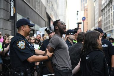 White policeman, Black protestor